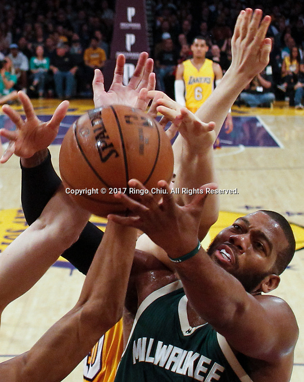 Milwaukee Bucks forward Greg Monroe (#15) and Los Angeles Lakers battle for a rebound during an NBA basketball game, Friday, March 17, 2017.(Photo by Ringo Chiu/PHOTOFORMULA.com)<br /> <br /> Usage Notes: This content is intended for editorial use only. For other uses, additional clearances may be required.