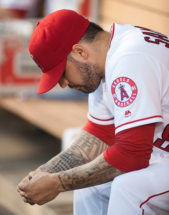 The Angels' Hector Santiago sits int he dugout after he was taken out of the game in the second inning against the Cleveland Indians Friday at Angel Stadium. Santiago gave up six runs, five earned, on seven hits in one and a third innings.<br /> <br /> ///ADDITIONAL INFO:   <br /> <br /> angels.0611.kjs  ---  Photo by KEVIN SULLIVAN / Orange County Register  -- 6/10/16<br /> <br /> The Los Angeles Angels take on the Cleveland Indians Friday at Angel Stadium.