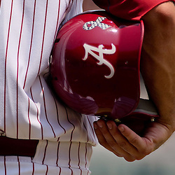 June 05, 2011; Tallahassee, FL, USA; A Alabama Crimson Tide player holds a batting helmet with a ribbon in support of those lost during the Tuscaloosa tornado outbreak  during the first inning of the Tallahassee regional of the 2011 NCAA baseball tournament against the UCF Knights at Dick Howser Stadium. Alabama defeated UCF 12-5. Mandatory Credit: Derick E. Hingle