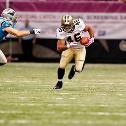 October 3, 2010; New Orleans, LA, USA; New Orleans Saints running back Ladell Betts (46) runs away from Carolina Panthers linebacker Dan Connor (55) during the second quarter at the Louisiana Superdome. Mandatory Credit: Derick E. Hingle