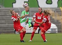 DETTE BILDET INNGÅR IKKE I FASTAVTALER PÅ NETT OG VIL BLI FAKTURERT VED SLIK BRUK.<br /> <br /> Fotball<br /> 30.08.2014<br /> Foto: imago/Digitalsport<br /> NORWAY ONLY<br /> <br /> Caroline Graham Hansen (VfL Wolfsburg) gegen drei Gegnerinnen. VfL Wolfsburg 3-0 SC freiburg<br /> <br /> 1.Bundesliga - Saison 2014/2015<br /> 1.Spieltag: VfL Wolfsburg - SC Freiburg