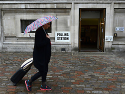 © Licensed to London News Pictures. 03/05/2012. Westminster, UK A woman walks past a polling station at Central Methodist Hall during the Mayoral Elections in London today 3rd May 2012 . Photo credit : Stephen Simpson/LNP