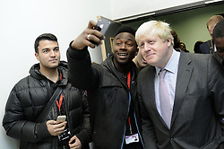 © Licensed to London News Pictures. 07/10/2014<br /> Students taking selfies with Boris.<br /> Mayor of London Boris Johnson has officially opened the new Erith Campus for Bexley College this morning(07.10.2014) in Walnut Tree Road,Erith,Greater London.<br /> (Byline:Grant Falvey/LNP)