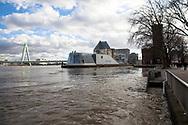 Cologne, Germany, February 4th. 2021, flood of the river Rhine, view to the Severins bridge and the Chocolate Museum.<br /> <br /> Koeln, Deutschland, 4. Februar 2021, Hochwasser des Rheins, Blick zur Severinsbruecke und zum Schokoladenmuseum.