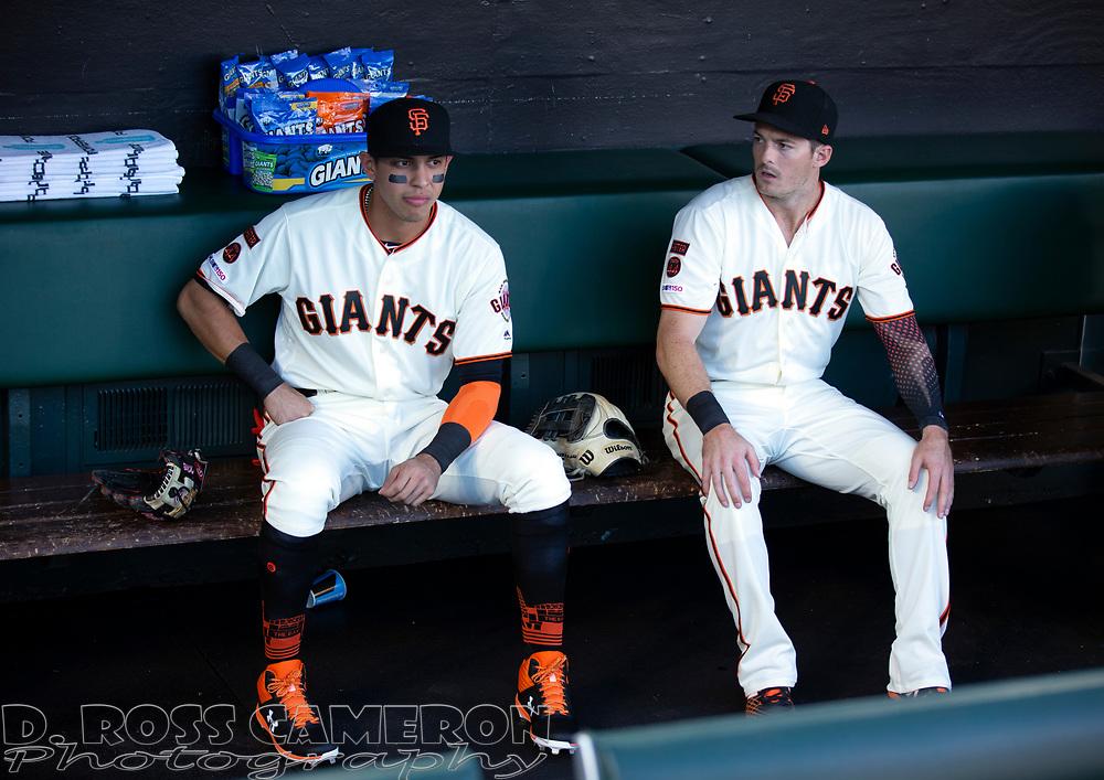 San Francisco Giants second baseman Mauricio Dubon, left, and left fielder Mike Yastrzemski chat in the dugout before a baseball game, Thursday, Aug. 29, 2019, in San Francisco. (AP Photo/D. Ross Cameron)