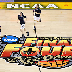 Apr 9, 2013; New Orleans, LA, USA; Connecticut Huskies jog onto the court for warm ups before the championship game in the 2013 NCAA womens Final Four against the Louisville Cardinals at the New Orleans Arena. Mandatory Credit: Derick E. Hingle-USA TODAY Sports