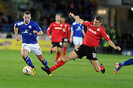 Leicester's Danny Drinkwater (l) is tackled by Cardiff's Ben Nugent. NPower championship, Cardiff city v Leicester city at the Cardiff city stadium in Cardiff, South Wales on Tuesday 12th March 2013.  pic by  Andrew Orchard, Andrew Orchard sports photography,