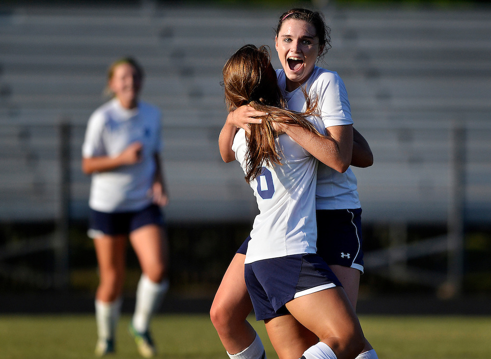 Hilton Head Island High School junior Brennan O'Gorman celebrates with teammate Rebecca Johnston after scoring a goal from in the midfield during the 4-A playoffs at Hilton Head Island on May 19, 2014.
