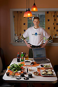 """Michael Rae, with his typical day's worth of precisely weighed food that comprises his calorie restricted daily diet, in the kitchen of his suburban Philadelphia home. (From the book What I Eat: Around the World in 80 Diets.) The caloric value of his day's worth of food in July was fixed at 1,900 kcals. He is 32; 5'11,5"""" and 114 pounds. Michael is research assistant to the theoretician and biomedical gerontologist Aubrey de Grey, and they are the coauthors of the book """"Ending Aging""""."""