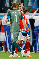 June 19, 2018 - Saint Petersburg, Russia - Roman Zobnin (R) and Igor Akinfeev of Russia national team celebrate victory during the 2018 FIFA World Cup Russia group A match between Russia and Egypt on June 19, 2018 at Saint Petersburg Stadium in Saint Petersburg, Russia. (Credit Image: © Mike Kireev/NurPhoto via ZUMA Press)