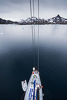 Aerial view of sailboat sailing through ice filled water of Kong Oscars Havn, Tasiilaq, Greenland