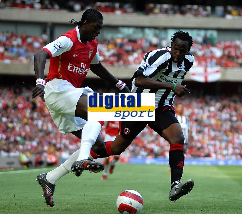 Photo: Ed Godden.<br />Arsenal v Sheffield United. The Barclays Premiership. 23/09/2006. Arsenal's Emmanuel Adebayor (L) runs clear of Claude Davis.