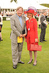 DAVID MELLOR and PENELOPE, VISCOUNTESS COBHAM  at the third day of the 2010 Glorious Goodwood racing festival at Goodwood Racecourse, Chichester, West Sussex on 29th July 2010.