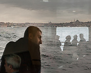 On the ferry boats crossing the Bosphorus.<br /> Life on and along the Bosphorus, in Istanbul, Turkey. The Bosphorus is a strait that forms part of the boundary between Europe and Asia.