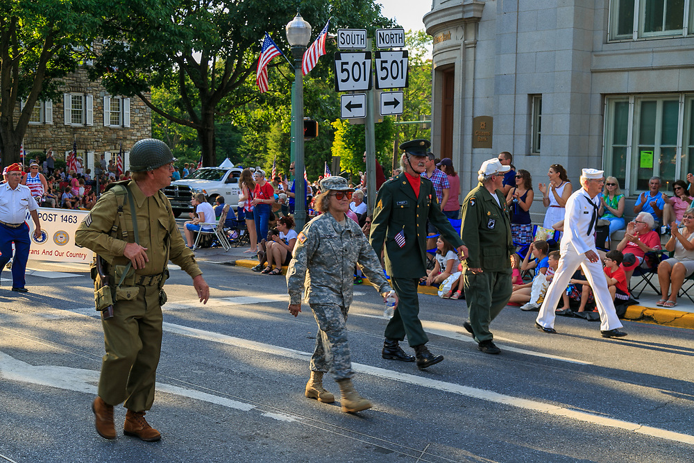 Lititz, PA / USA - July 3, 2017:   Military members lead the parade in a small American town in observance of the 4th of July Independence Day celebration.