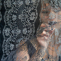 Fashion designer Rachel Riot stitches a few final adjustments on a grey lace creation she calls her 'Zsa Zsa Gown' in her Santa Cruz workshop as she prepares her collection for the annual FashionART Santa Cruz runway show.<br /> Photo by Shmuel Thaler <br /> shmuel_thaler@yahoo.com www.shmuelthaler.com