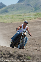 Riding the Flat Track at the Broken Spoke Campground during the 75th Annual Sturgis Black Hills Motorcycle Rally.  SD, USA.  August 6, 2015.  Photography ©2015 Michael Lichter.