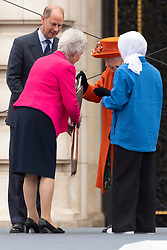 © Licensed to London News Pictures. 07/10/2021. London, UK. Photo credit: Queen Elizabeth II puts a message in the baton launching the Queens Baton Relay event held at Buckingham Palace for Birmingham 2022 Commonwealth Games. Photo by London News Pictures