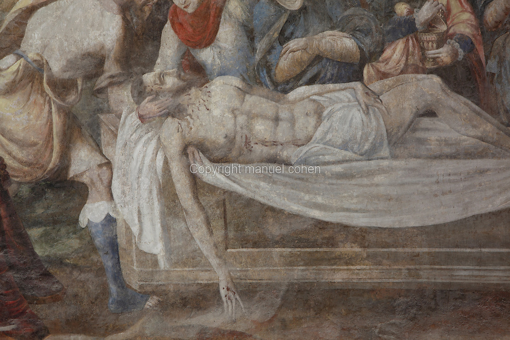 Christ's body, detail from the Entombment fresco, Chapter House, Fontevraud Abbey, Fontevraud-l'Abbaye, Loire Valley, Maine-et-Loire, France. The Chapter House was built in the 16th century and its walls were painted in 1563 with frescoes of scenes from Christ's Passion by the Anjou artist Thomas Pot. The abbey itself was founded in 1100 by Robert of Arbrissel, who created the Order of Fontevraud. It was a double monastery for monks and nuns, run by an abbess. Picture by Manuel Cohen
