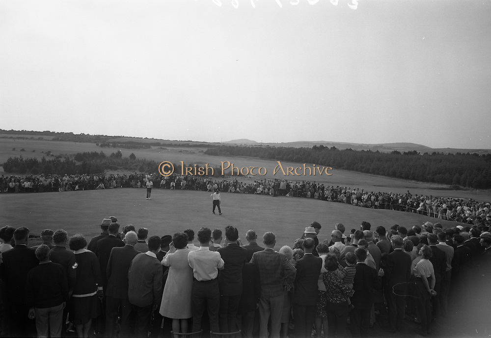 20/08/1967<br /> 08/20/1967<br /> 20 August 1967<br /> Irish Dunlop £1,000 Tournament at Tramore Golf Club, Co. Waterford. Christy O'Connor waves to the gallery on the 18th after winning the competition with runner up Hugh Boyle also on the green.