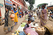 The City Market is photographed in Bangalore, Karnataka, India. On these very same pavements Shafiq Syed, now 34, used to sleep and make a meagre living when he escaped various times from his father's home at the tender age of 11 to live as a street child here first, and then in Mumbai. It was during the time living next to Churchgate train station, in central Mumbai, that he was selected to become the main character for the cast of Cannes' Camera D'Or 1988 winner Salaam Bombay. After the movie he failed to become a star, fell back into poverty and lived on the streets for years before he moved on to become a rickshaw (tuk-tuk) driver in his home city of Bangalore, Karnataka State, India.