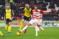 Matthew Lund of Scunthorpe United (7) is tackled by John Marquis of Doncaster Rovers (9) during the EFL Sky Bet League 1 match between Doncaster Rovers and Scunthorpe United at the Keepmoat Stadium, Doncaster, England on 15 December 2018.