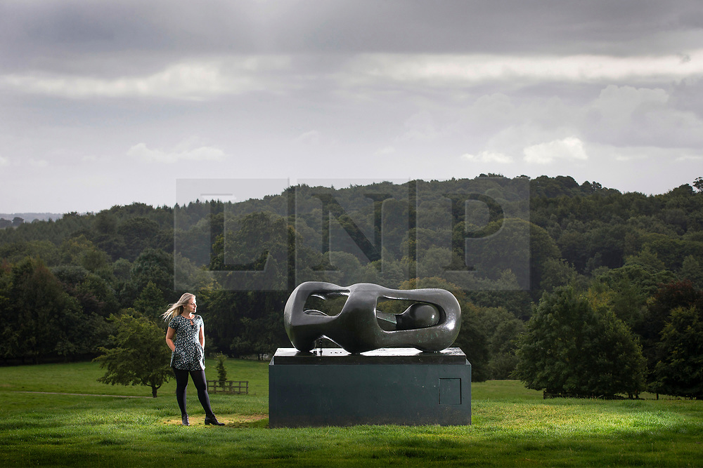 © Licensed to London News Pictures. 06/09/2017. Wakefield UK. Millie Carrol looks at the Henry Moore sculpture 'Reclining Connected Forms'  from 1969 that has been placed on display at the Yorkshire Sculpture Park as part of their 40th anniversary celebrations. Photo credit: Andrew McCaren/LNP