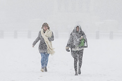 © Licensed to London News Pictures. 27/02/2018. London, UK. Two women brave heavy snow on Horse Guards Parade in central London. Severe cold, blizzards and heavy snow are expected for the rest of the week as the 'Beast from the East' brings freezing Siberian air to the UK. Photo credit: Rob Pinney/LNP