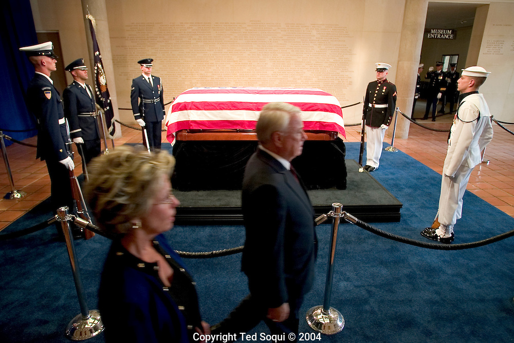 Ronald Reagan's casket laying in repose at the Ronald Reagan library. Members of the public are ushered by to pay their respects to him..Ronald Reagan Library, Simi Valley, CA USA 6/7/04.