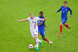 PARIS, FRANCE - Sunday, July 3, 2016: Iceland's Kolbeinn Sigthórsson and France's Paul Pogba during the UEFA Euro 2016 Championship Semi-Final match at the Stade de France. (Pic by Paul Greenwood/Propaganda)