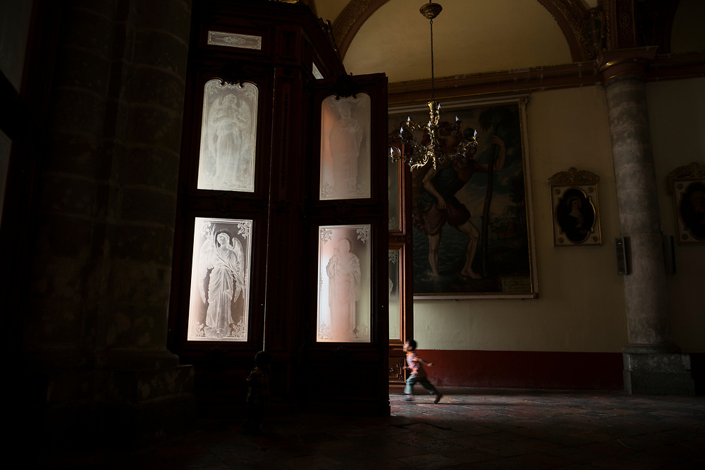 A young boy runs toward the exit inside the Cathedral of Our Lady of the Assumption in the Mexican city of Oaxaca.
