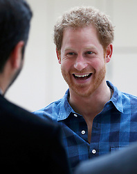 Prince Harry arrives to watch a rehearsal of the Joyful Noise choir, a group from NAZ, a sexual health charity for minority communities, at The Hurlingham club in London.