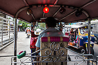 Bangkok Tuk-Tuk Ride - The samlor, meaning three-wheeler in Thailand and are usually referred to as a tuk-tuk mimicking the sound of a noisy two-cycle engine.  However, the tuk-tuk is starting evolve from the old smoke-spewing vehicle of the past with many fitted with low emission engines, or refitted with LPG conversions.  There are no meters, and trip costs are negotiated in advance.