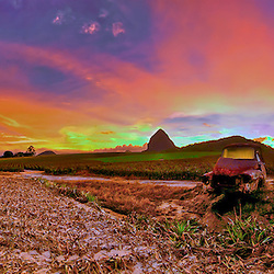 Beerwaw Pineapple fields, Queensland By Jaydon cabe, showing an old rusty car int eh middle of a field