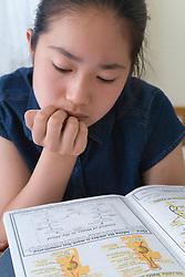Teenage girl doing her homework,