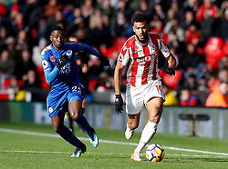 Stoke City's Eric Maxim Choupo-Moting (right) and Leicester City's Wilfred Ndidi (left) battle for the ball