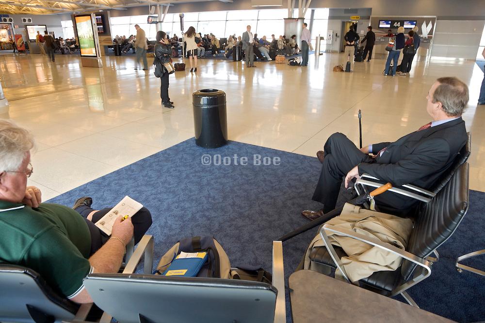 waiting passengers at an JFK airport terminal