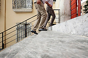 low angle view of two senior people walking up the stairs