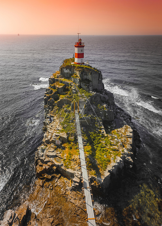 Aerial view of beautiful lighthouse at sunrise in Vladivostok, Russia.