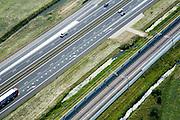 Nederland, Gelderland, Andelst-Zetten, 28-06-2006; Rijksweg A15 met parallel daar aan de Betuweroute, aan beiden zijden voorzien van geluidsscherm; oorspronkelijk bevond zich op deze plaats een boomgaard; verkeer en vervoer, energie, milieu, bouw, transport, infrastructuur, mobiliteit, planologie; zie ook andere (lucht)foto's van deze lokatie, deel van de serie Panorama Nederland luchtfoto (toeslag aerial photo (additional fee required .foto Siebe Swart / photo Siebe Swart