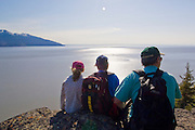 McHugh Creek Recreation Area, Chugach National Forest, A Father and his kids taking a moment to enjoy the scenic view over Turnagain Arm and Cook inlet from a trail just above the Seward Highway.