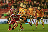 Adam Forshaw (Middlesbrough) runs around the Wolves player to get to the ball during the Sky Bet Championship match between Middlesbrough and Wolverhampton Wanderers at the Riverside Stadium, Middlesbrough, England on 4 March 2016. Photo by Mark P Doherty.