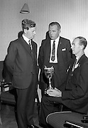 24/07/1967<br /> 07/24/1967<br /> 24 July 1967<br /> Handing over Irish Mist Trophy to Federation of Irish Beekeepers at Gormanstown College, Co. Meath. At the official opening of the 1967 Summer Course of the Federation of Irish Beekeepers at Gormanstown College Co. Dublin, a new Perpetual Challenge Trophy was handed over to the Federation by the Irish Mist Liqueur Co., Tullamore, to be awarded each year for the supreme run honey entered at the Irish National Honey Show. That years show was held on the 27 July. Photo shows Mr. W.G. Jaffray (left), Director Irish Mist Liqueur Co., handing over the Irish Mist Trophy to Mr. J.J. Doran (right), Kilkenny, President of the Federation and Mr. J.A. Ahern, (Cork) Secretary of the Federation.