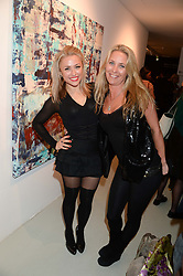 Left to right, actress TIEVA LOVELLE and artist KATARINA BALIOVA at a private view of an exhibition of paintings by Billy Zane entitled 'Save The Day Bed' held at the Rook & Raven Gallery, Rathbone Place, London on 10th October 2013.