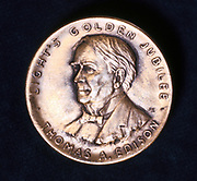 Thomas Alva Edison (1847-1931) American physicist and inventor. From the obverse of a medal celebrating the 50th anniversary of his invention of the incandescent lamp