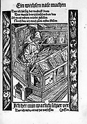 Medieval book collector sitting at desk, reading By Sebastian Brandt 1458-1521. Published 1494, woodcut.