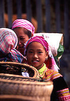 A traditonally dressed young flower hmong girl at a market in Northern Vietnam.