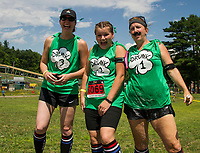 """The """"Beer-ly There"""" team of Beth Glover, Nicole Brown and Carol Chase watch as their team mate Bob Chase nativages the Slip 'N Dip event during Gunstock Mountain's Craft Beer Relay on Saturday.  (Karen Bobotas/for the Laconia Daily Sun)"""
