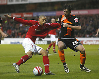 Photo: Richard Lane/Richard Lane Photography. Nottingham Forest v Blackpool. Coca Cola Championship. 13/12/2008. Nathan Tyson (L) and Shaun Barker (R) tangle and tug shirts