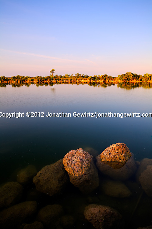 A tranquil early morning view of a small lake in the Florida Everglades. WATERMARKS WILL NOT APPEAR ON PRINTS OR LICENSED IMAGES.